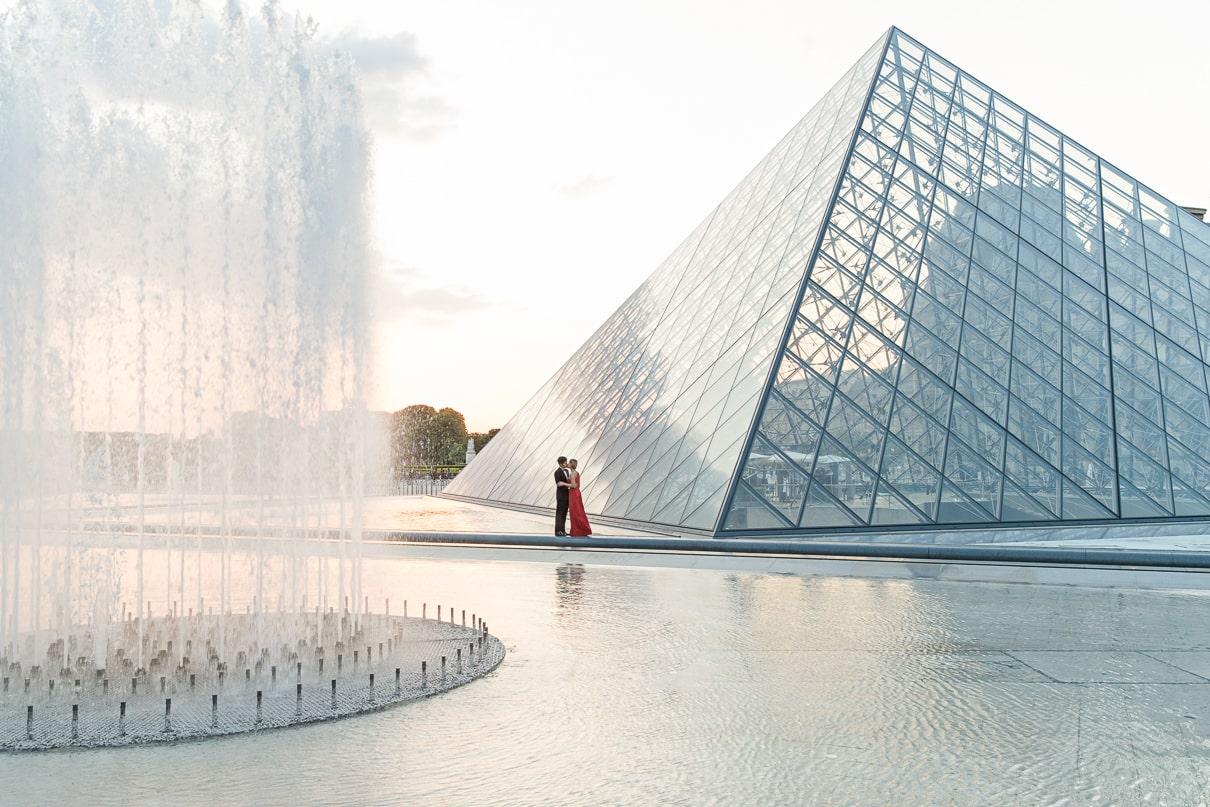 Paris photographer paris engagement photos Louvre Museum at sunrise