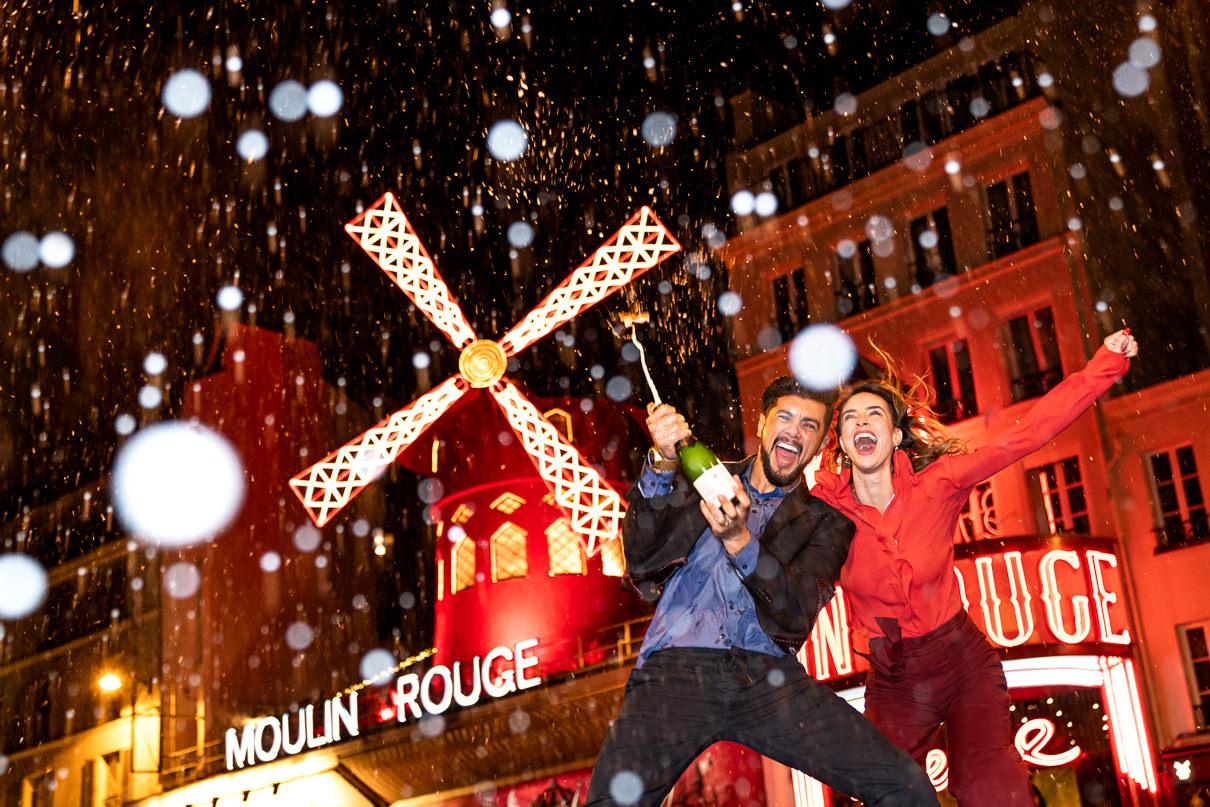 Best Paris photographer Moulin Rouge Paris engagement photo session
