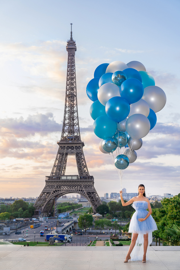 Eiffel Tower maternity photos gender reveal with blue balloons