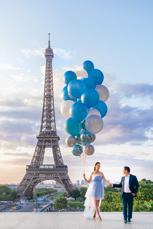 Gender reveal Eiffel Tower photos with blue balloons