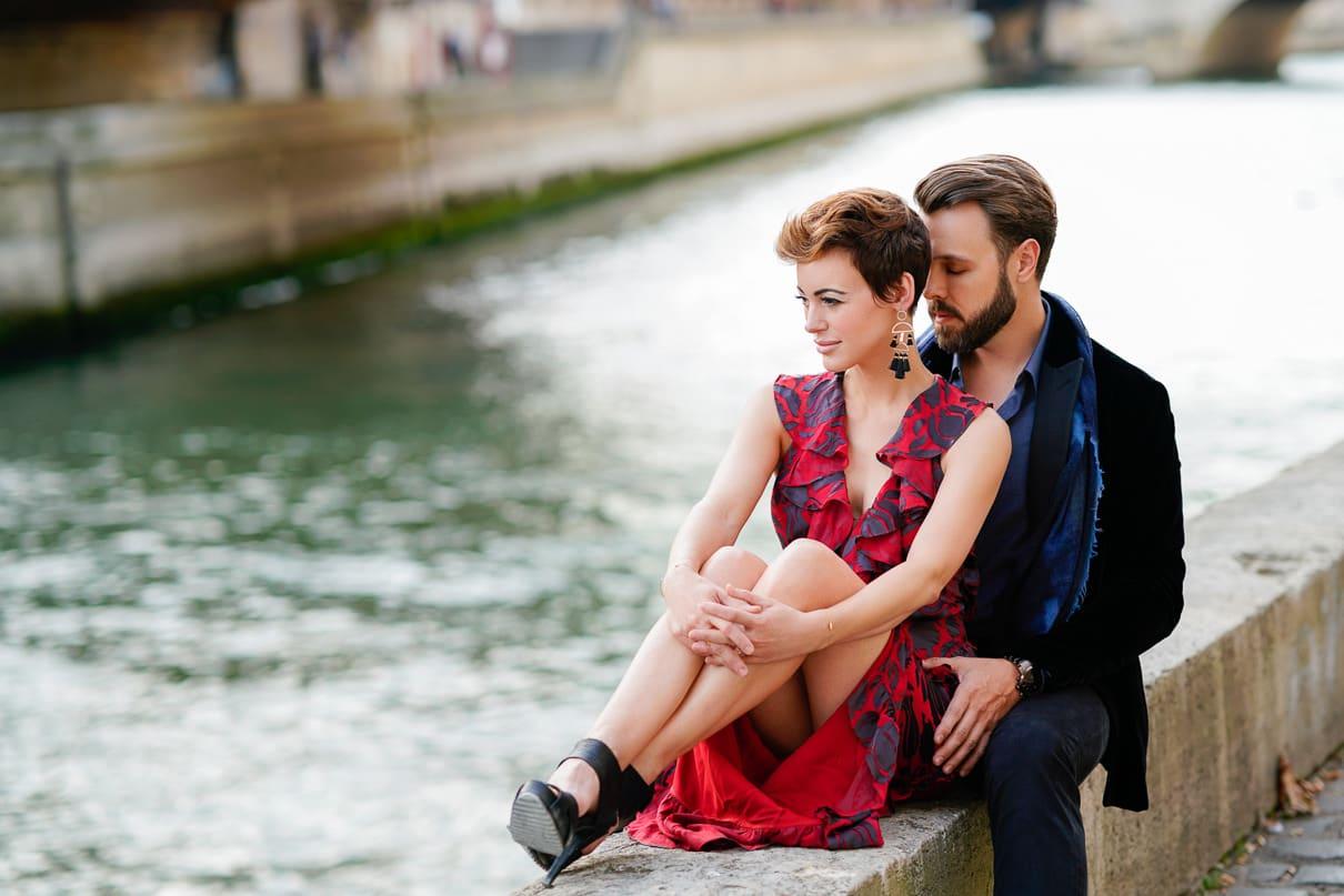 Romantic Paris engagement photos along the Seine River by Notre Dame