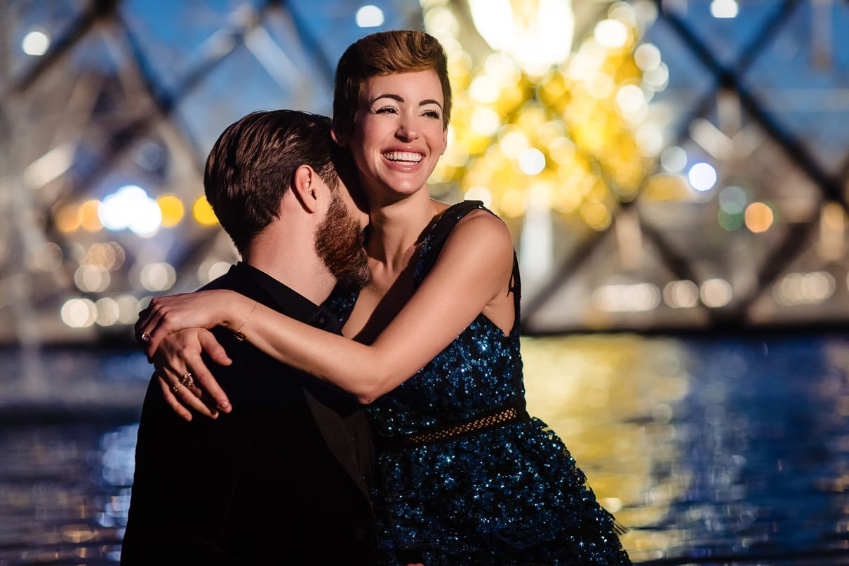 Romantic Paris engagement photos at the Louvre at night during the Blue Hour